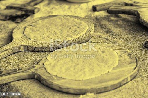 istock Artisan kneading dough for cakes wheat 1071918094
