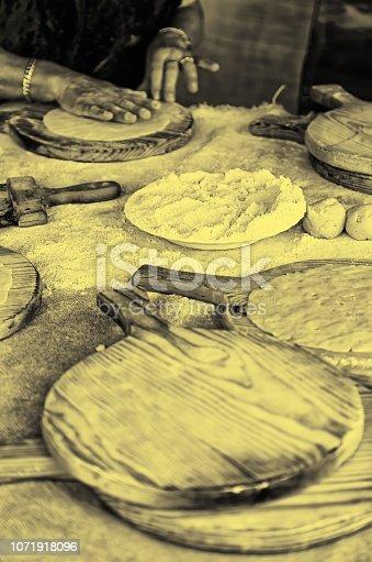 istock Artisan kneading dough for cakes wheat 1071918096