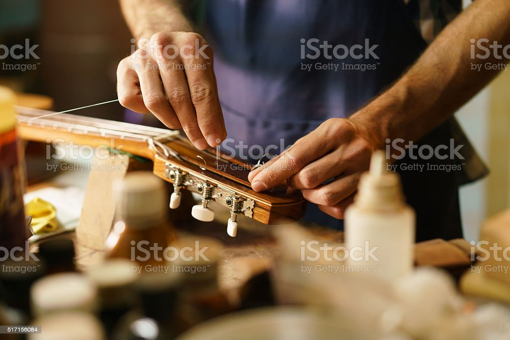 Artisan Lute Maker Fixing Stringed Instrument Replacing Guitar C stock photo