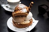 italian sweet, brioche and ice cream with latte