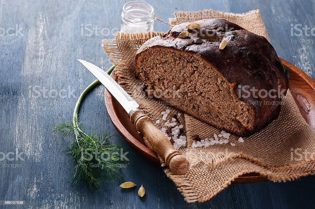 Artisan rye bread over wooden background stock photo