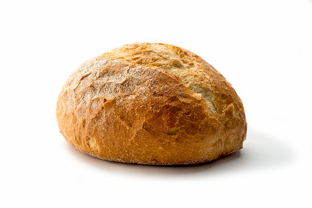 artisan  white Bread Fresh loaf of homemade bread on white background round loaf stock pictures, royalty-free photos & images