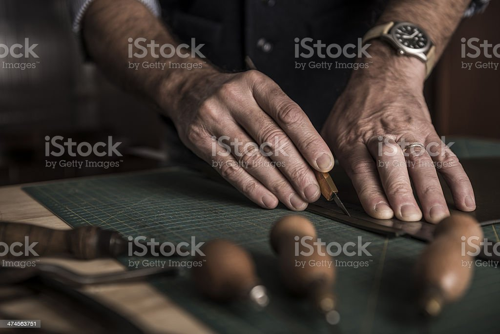 Artisan working with leather stock photo