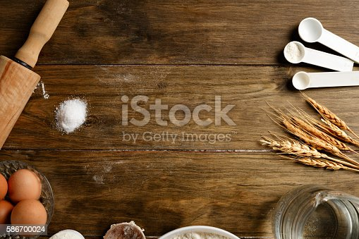 istock Artisanal Bakery: Frame of dough making ingredients and utensils 586700024