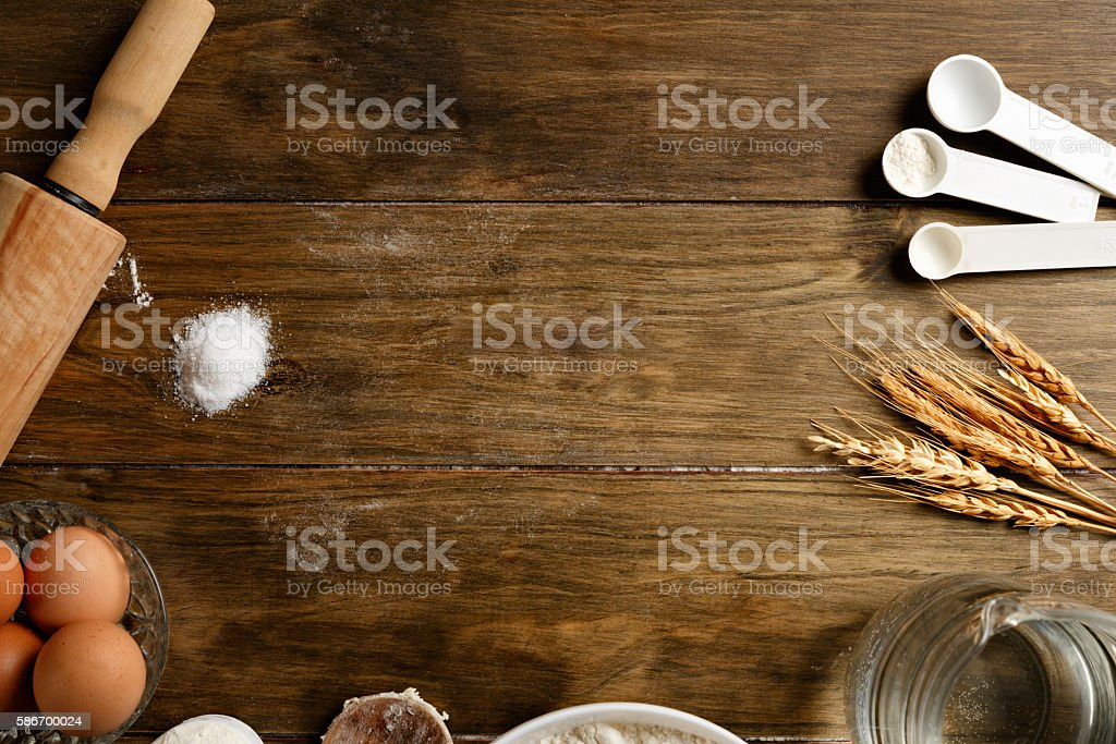 Artisanal Bakery: Frame of dough making ingredients and utensils stock photo