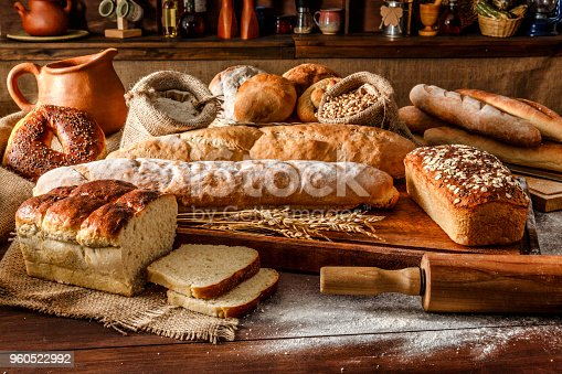 Artisanal bakery: Group of fresh mixed breads and rolls. Artisanal bakery is bread made by a craftsperson using mainly traditional techniques. Also, it is usually made by hand, however, many artisanal bakeries use also electrical mixers and dividers. The bakers who do everything by hand tend to draw a line differently than the bakers who use lots of automated equipment. Artisanal bakery, only made by hand, is part of the romantic and traditional way of cooking from old times.