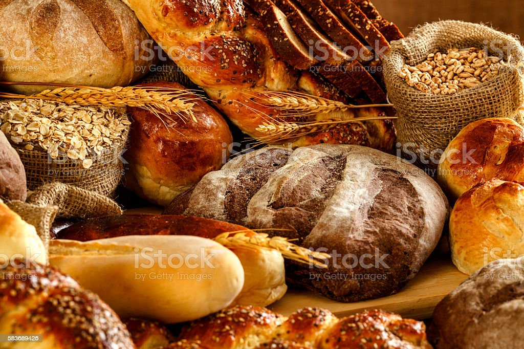 Artisanal bakery:  Fresh mixed Bun, rolls and Sourdough Bread stock photo