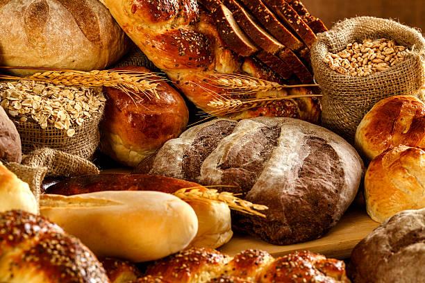 Artisanal bakery:  Fresh mixed Bun, rolls and Sourdough Bread stock photo