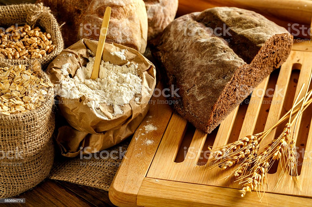 Artisanal bakery: Sourdough Bread and variety of Bun products stock photo
