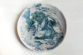 From above photo of artisan's handmade ceramic painted plate.