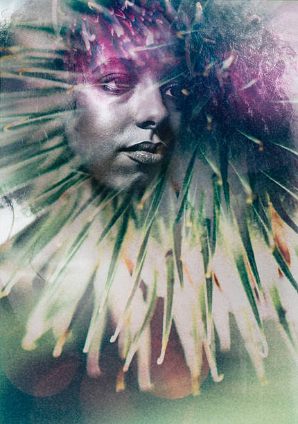 Artisitc image of a woman's face double exposed with foliage stock photo