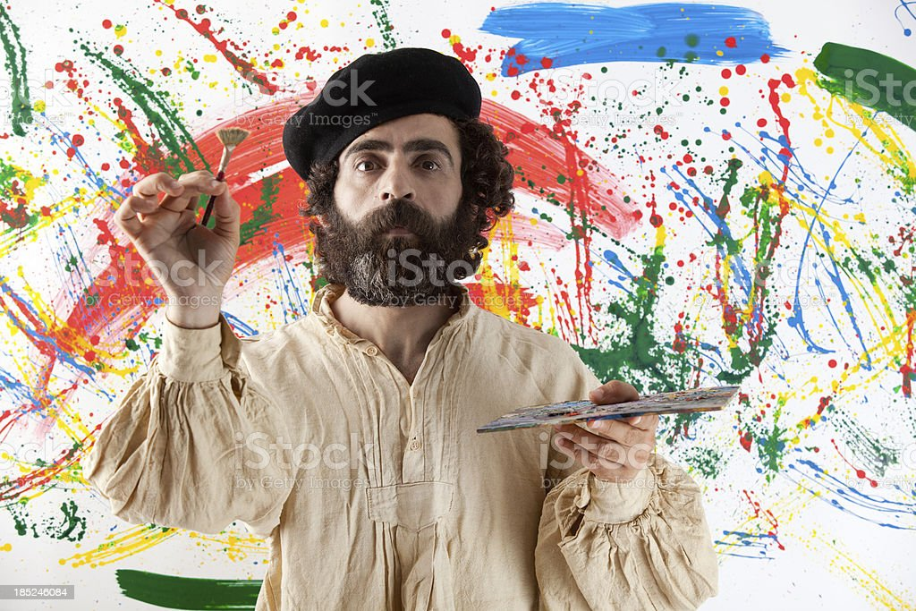Artist adult man standing before painting royalty-free stock photo