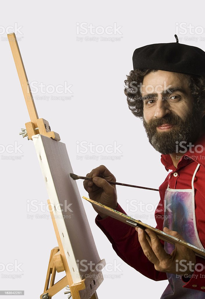 Artist adult man starting to panit with a blank canvas royalty-free stock photo