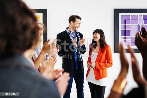 istock Artist And Gallery Owner During Opening 618963072