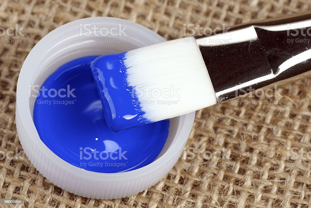artist brush with blue paint royalty-free stock photo