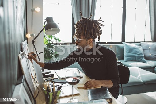 Men working in living room on some drawings