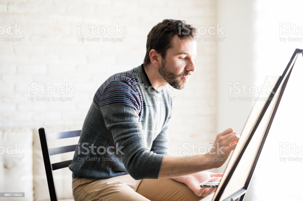 Artist concentrating on his new artwork - Royalty-free 30-39 Years Stock Photo