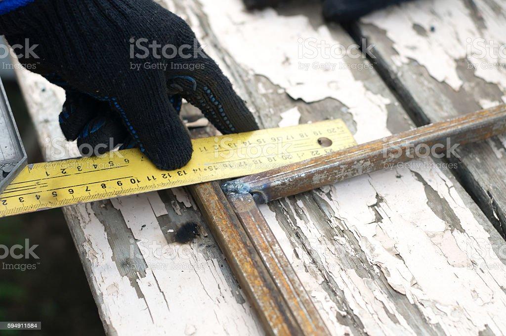 Artist constructing artwork from metal closeup stock photo