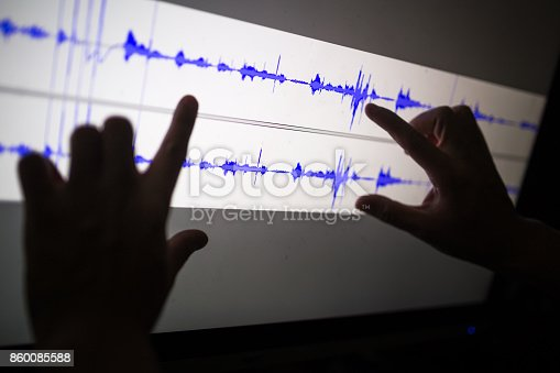 istock artist cut audio signal in the touch screen computer 860085588