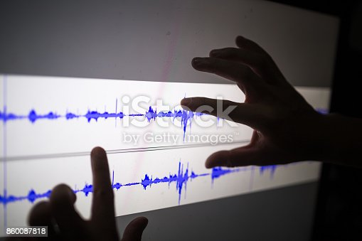 istock artist cut audio signal in the touch screen computer 860087818