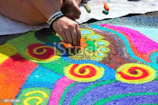 istock Artist doing a Bright chalk street painting 180748388