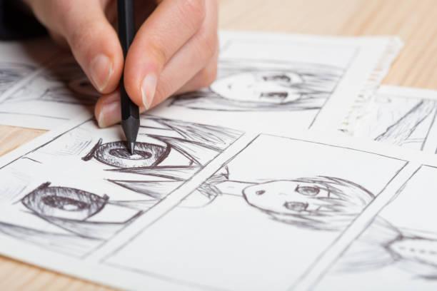 Artist drawing an anime comic book in a studio picture id1241563343?b=1&k=6&m=1241563343&s=612x612&w=0&h=kmtjh6pj29bk69yb2kqfej enpsd6evhvw i9zij0n8=