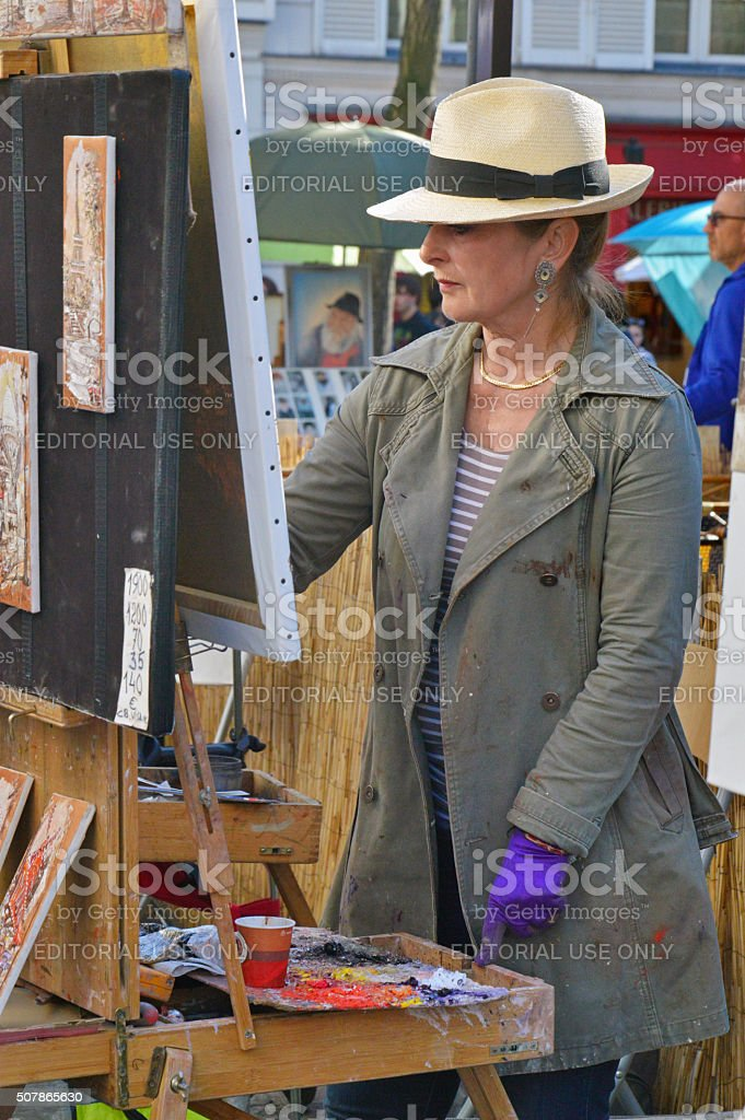 Artist drawing at Place du Tertre, Montmartre stock photo