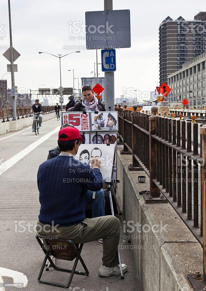Artist Drawing on Brooklyn Bridge, NYC royalty-free stock photo