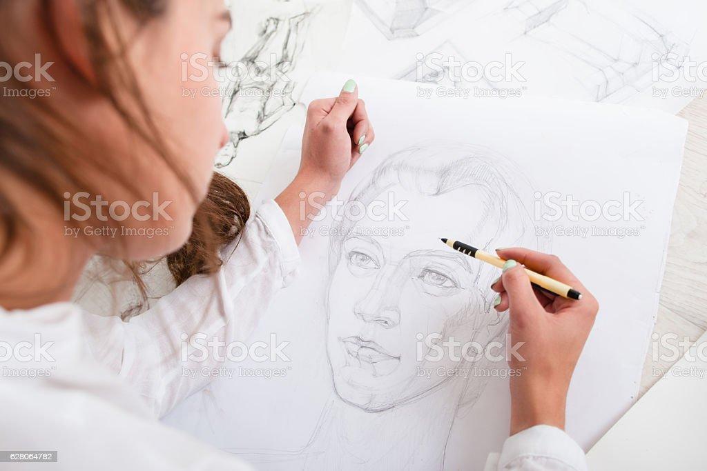 Artist drawing pencil portrait close-up stock photo