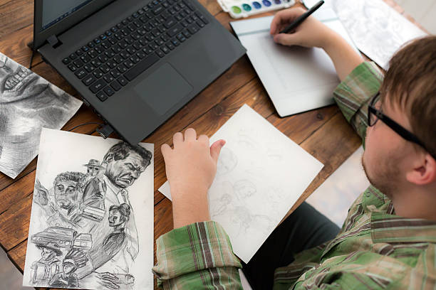Artist drawing Sketch on Graphic Tablet Top View Young Man designer occupation drawing sketch using paper and graphic tablet top view illustrator stock pictures, royalty-free photos & images
