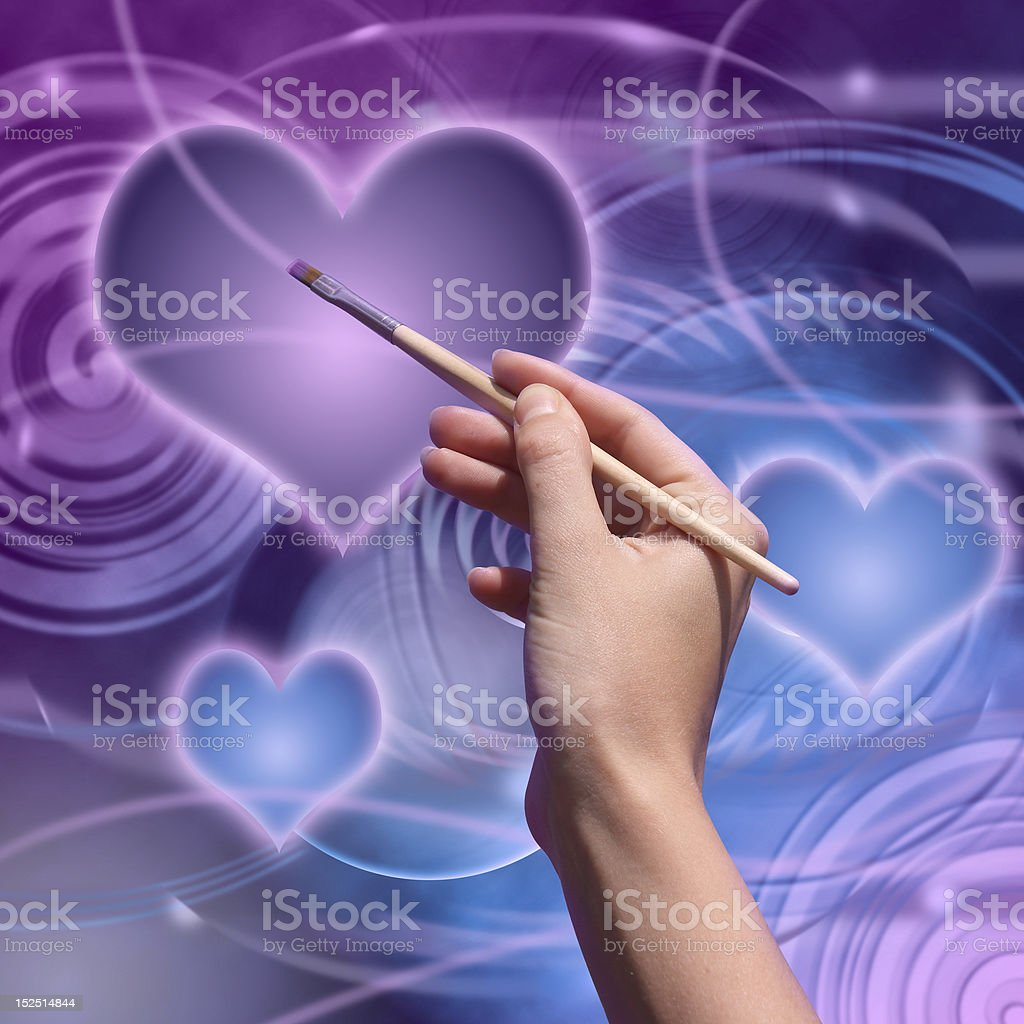 Artist draws a love planet royalty-free stock photo