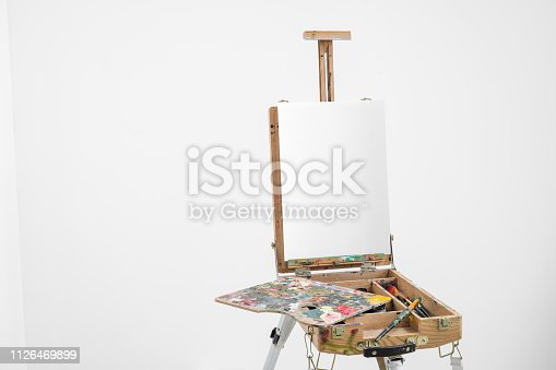 671393252 istock photo Artist easel with blank canvas on a white background. 1126469899