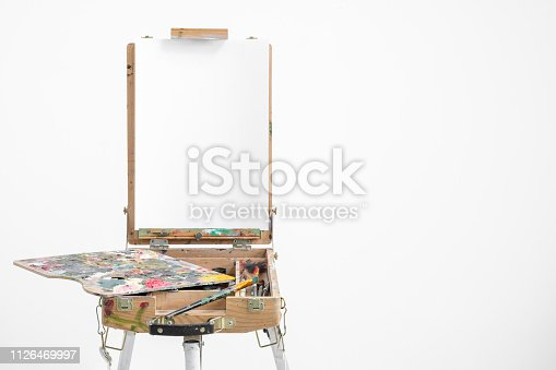 istock Artist easel with blank canvas on a white background. 1126469997