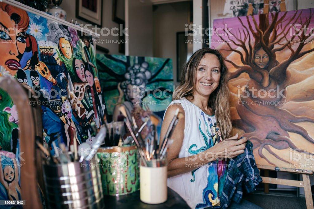 Artist in her studio stock photo