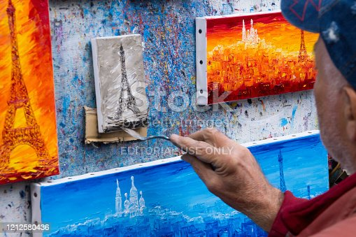 Paris France October 9, 2014 Artist is making  of Eiffel Tower's  oil painting picture in the montmartre district