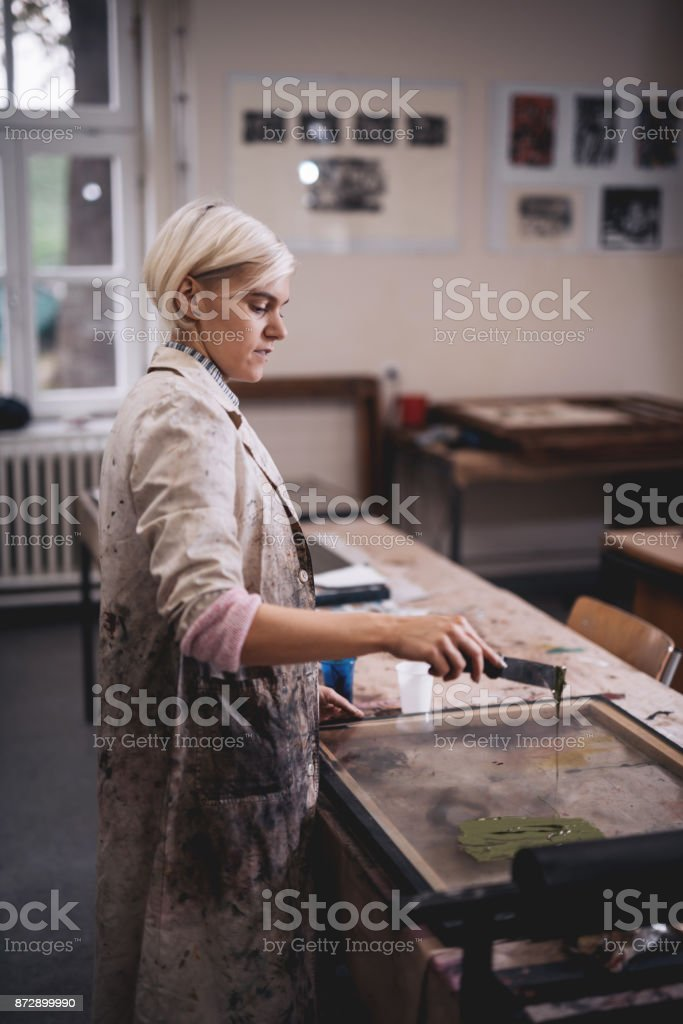 Artist is mixing colors for the painting stock photo