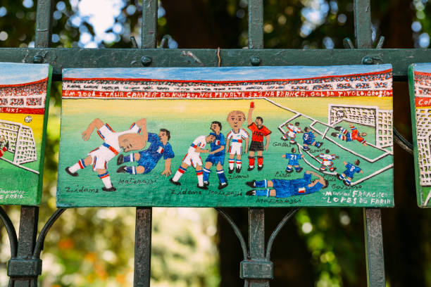 artist next to his paintings depecting iconic moments in footbal - ronaldo imagens e fotografias de stock