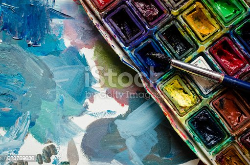 istock Artist paint brush and watercolor paintbox 1023769636