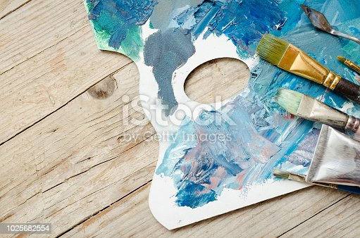 istock Artist paint brushes and oil paint tubes 1025682554