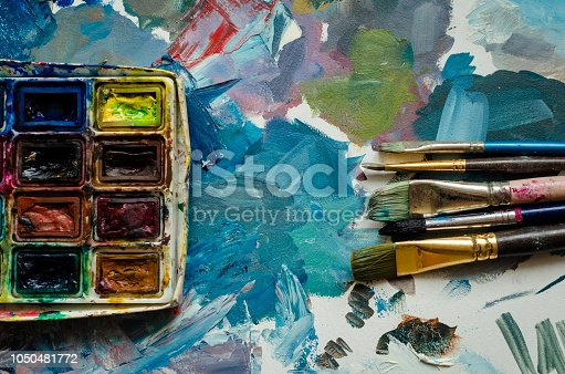 istock Artist paint brushes and watercolor paintbox 1050481772