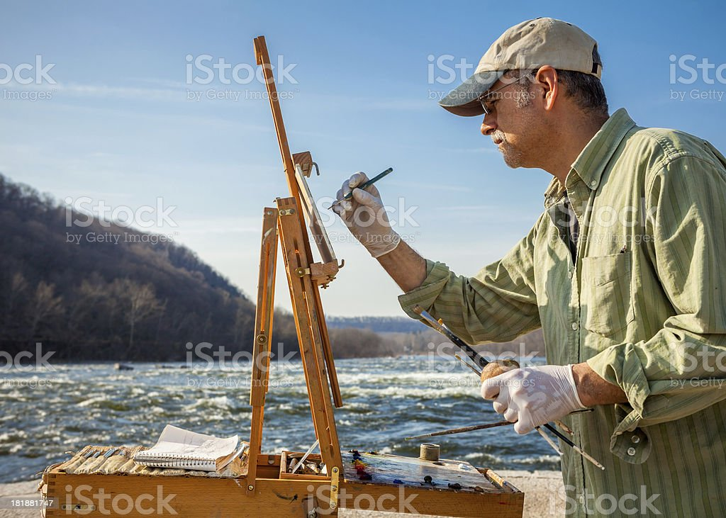 Artist Painting At Easel stock photo