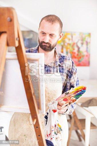 istock Artist painting at his studio-close up 538151194