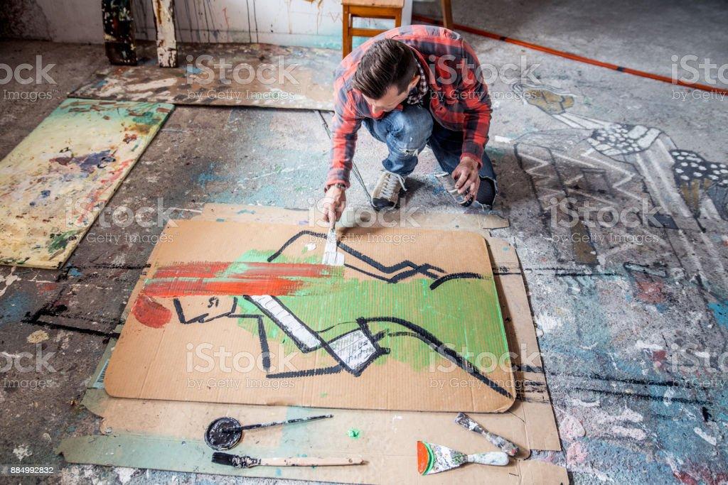 Photo De Stock De Artiste Peinture Toile Carton Sur Le Sol Images