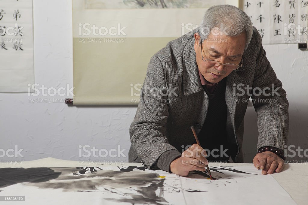 Artist painting in his studio stock photo