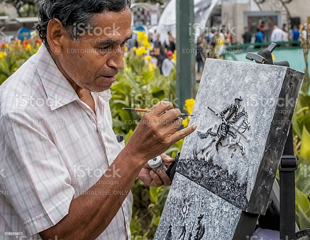 Artist painting on the street in Caracas Venezuela stock photo