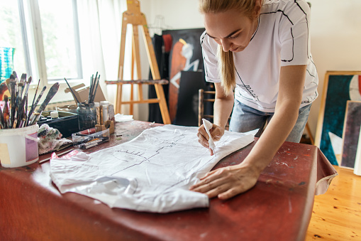 Artist painting on the textile