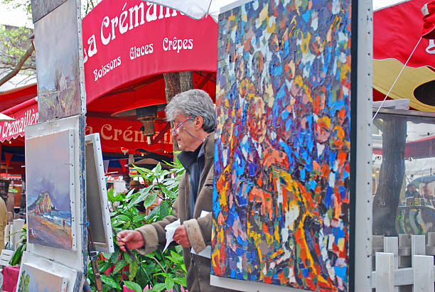 Artist painting outside in Montmartre, Paris stock photo
