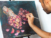 Artist painting red shallot on canvas