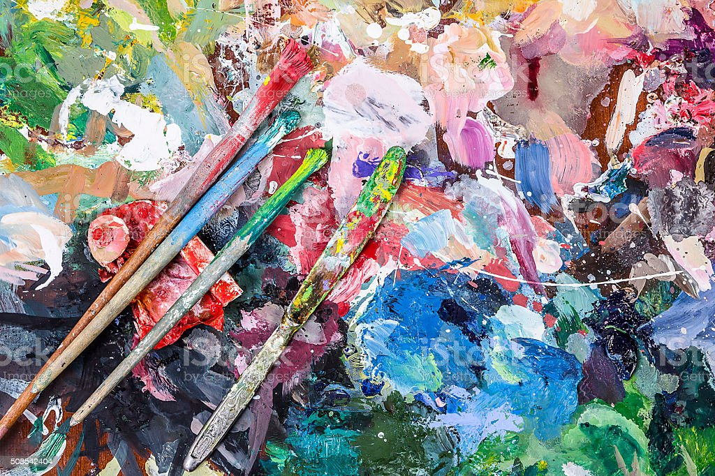 Artist palette for mixing paints and brushs with knife stock photo