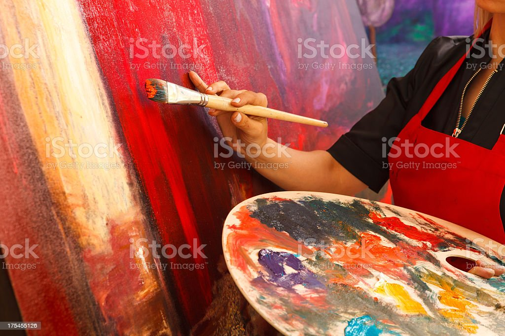 Artist putting the final magic touch on painting stock photo